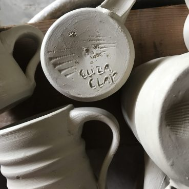 mugs in the works by Eliza Clay